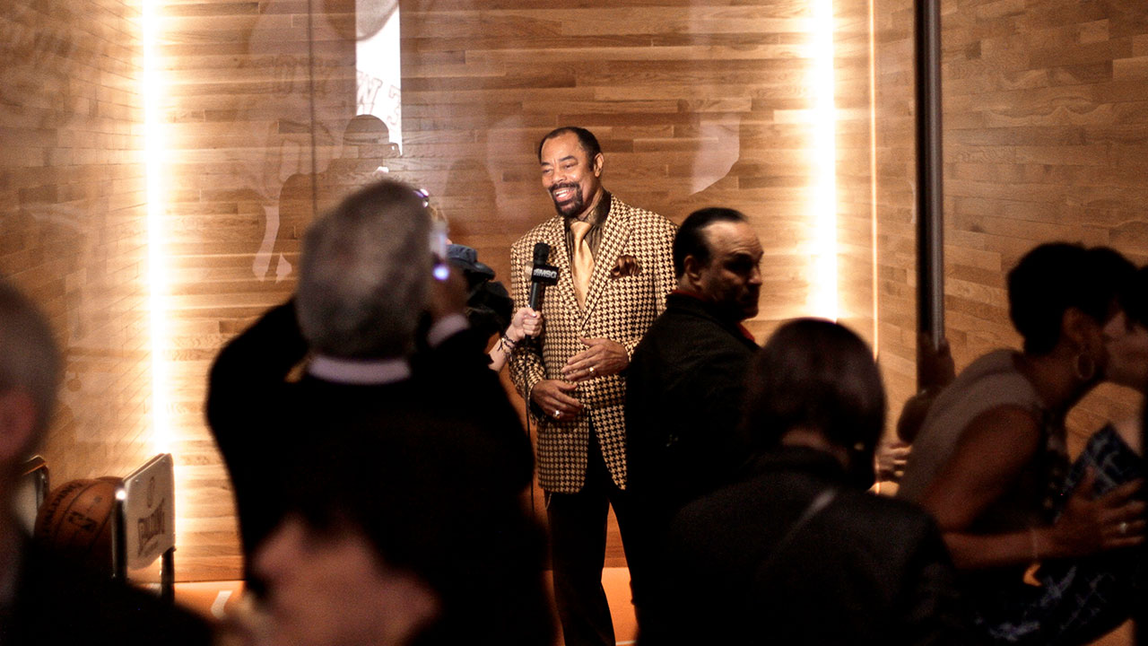 Clyde Frazier speaking at event at clydes